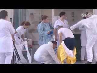 Путин посетил больницу в Коммунарке в защитном костюме