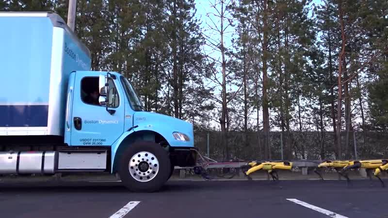 Упряжка гончих Boston Dynamics тянет грузовик